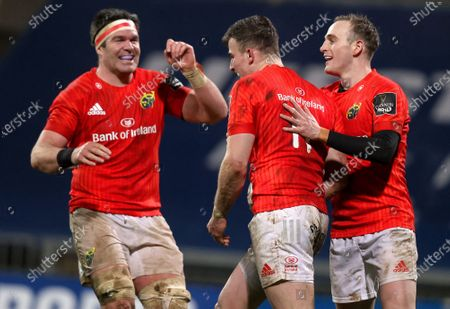 Munster vs Scarlets. Munster's Shane Daly celebrates scoring a try with Billy Holland and Nick McCarthy