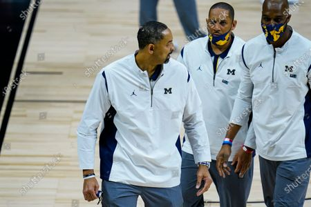 Michigan head coach Juwan Howard leaves the court after being ejected from the game in the second half of an NCAA college basketball game against Maryland at the Big Ten Conference tournament in Indianapolis