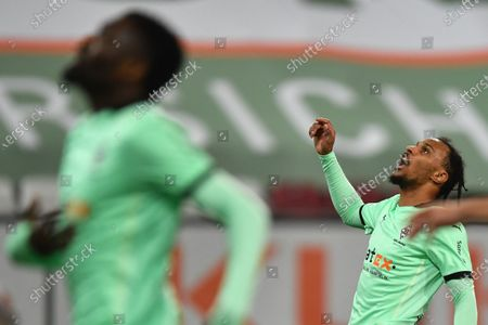 Moenchengladbach's Valentino Lazaro reacts during the German Bundesliga soccer match between FC Augsburg and Borussia Moenchengladbach in Augsburg, Germany, 12 March 2021.
