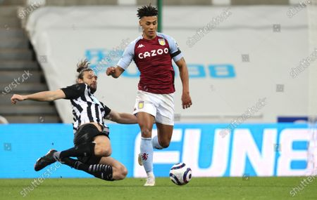 Newcastle's Andy Carroll, left, and Aston Villa's Ollie Watkins challenge for the ball during the English Premier League soccer match between Newcastle United and Aston Villa at the St James' Park stadium in Newcastle, England