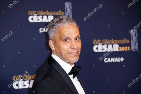 French Tunisian actor Sami Bouajila poses prior to the 46th Cesar Award ceremony on in Paris