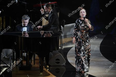 French singer Catherine Ringer, right, and Benjamin Biolay performs during the 46th Cesar Award ceremony on in Paris