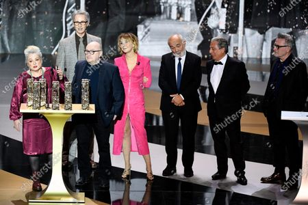 Stock Image of From left actress Josiane Balasko, French actor Thierry Lhermitte, French director and actor Michel Blanc, French, French actress Marie-Anne Chazel, French actor Gerard Jugnot, French actor Christian Clavier and French actor Bruno Moynot stand on stage next to French actress and Master of Ceremony Marina Fois and French actor Laurent Lafitte after receiving the Anniversary award during the 46th Cesar Award ceremony on in Paris