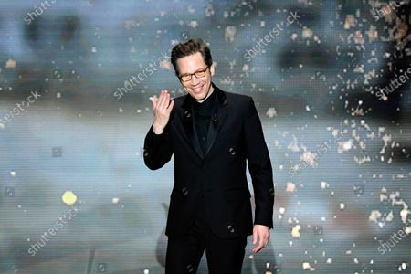 Stock Picture of French actor Reda Kateb arrives on stage to give the Best Sound award during the 46th Cesar Award ceremony on in Paris