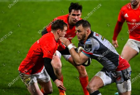 Stock Photo of Steff Hughes of Scarlets is tackled by Nick McCarthy of Munster
