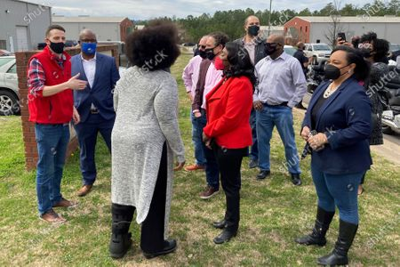 Rep. Terri Sewell, D-Ala, in the center wearing red, and Rep. Nikema Williams, D-Ga., at the far right, join fellow members of Congress, labor organizers and employees at an Amazon facility in Bessemer, Ala., on . The nearly 6,000 workers at the plant are voting on whether to form a union. The election is the largest unionizing effort ever for Amazon, one of the world's wealthiest firms, and would be a major victory for organized labor and its Democratic Party allies as the labor movement tries to reverse decades of declining membership nationally