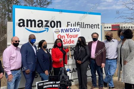 Democratic members of Congress join representatives of the Retail, Wholesale and Department Store Union gather outside an Amazon fulfillment center in Bessemer, Ala.,, to advocate for the ongoing unionization vote at the sprawling campus. The elected officials pictured include, starting second from left, Rep. Jamaal Bowman of New York, Nikema Williams of Georgia, Terri Sewell of Alabama, Cori Bush of Missouri and Andy Levin of Michigan
