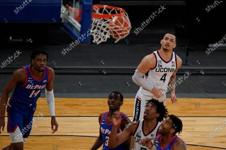 Connecticut's Tyrese Martin (4) watches his shot go in during the second half of an NCAA college basketball game against DePaul in the Big East conference tournament, in New York