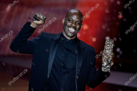 """French actor Jean-Pascal Zadi poses with his trophy after receiving the Best Male Newcomer award for the movie """"Tout simplement noir"""" (Simply Black) during the 46th Cesar Award ceremony on in Paris"""