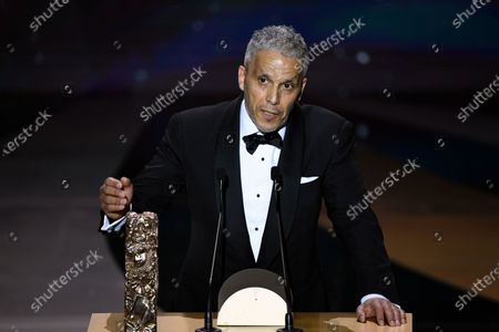 """French Tunisian actor Sami Bouajila delivers a speech after winning the Best Actor award for """"Un fils"""" (A Son) during the 46th Cesar Award ceremony on in Paris"""