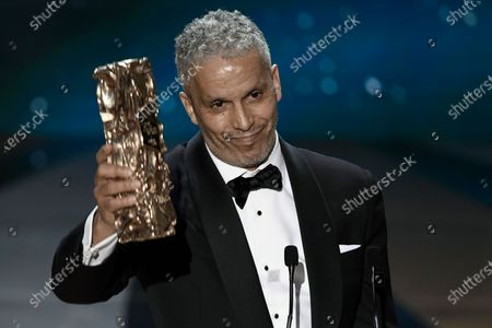 """French Tunisian actor Sami Bouajila celebrates after winning the Best Actor award for """"Un fils"""" (A Son) during the 46th Cesar Award ceremony on in Paris"""