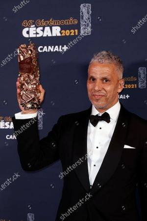 """French Tunisian actor Sami Bouajila poses after winning the Best Actor award for """"Un fils"""" (A Son) during the 46th Cesar Award ceremony on in Paris"""