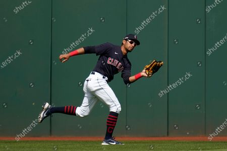 Cleveland Indians center fielder Oscar Mercado chases down a fly ball hit by Los Angeles Dodgers' A.J. Pollock during the fourth inning of a spring training baseball game, in Goodyear, Ariz