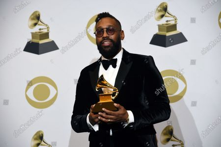"""Morton poses in the press room with the award for best R&B song for """"Say So"""" at the 62nd annual Grammy Awards at the Staples Center in Los Angeles. A New Orleans high school is celebrating Grammy nominations for four of its graduates. St. Augustine High School alumni PJ Morton, Timothy Thedford, Jonathan Batiste and Luke James are each up for best album in different categories at the awards show Sunday, March 14, 2021"""
