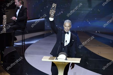 """French Tunisian actor Sami Bouajila poses with the trophy after winning the Best Actor award for """"Un fils"""" (A Son) at 46th Cesar Film Awards 2021 ceremony at l'Olympia in Paris on March 12, 2021 in Paris, France."""