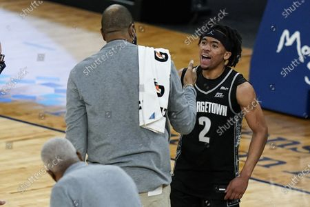 Georgetown's Dante Harris (2) celebrates with coach Patrick Ewing after the team's NCAA college basketball game against Seton Hall in the semifinals in the Big East men's tournament, in New York. Georgetown won 66-58