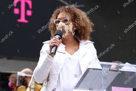 Stock Image of Tamara Tunie participating in We Will Be Back, presented by Broadway Cares/Equity Fights AIDS, NYCNext, and the Times Square Alliance, held in Duffy Square.