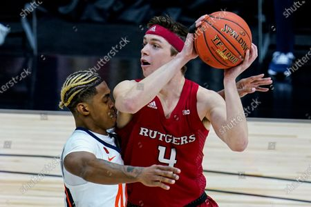 Rutgers guard Paul Mulcahy (4) is guarded by Illinois guard Adam Miller (44) during the first half of an NCAA college basketball game at the Big Ten Conference men's tournament in Indianapolis