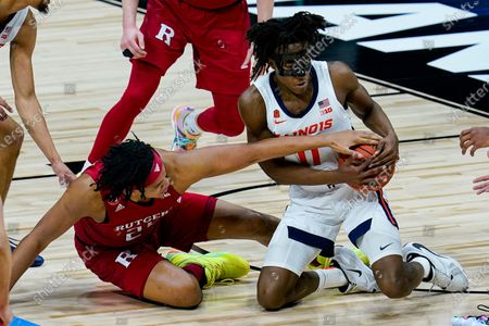 Illinois guard Ayo Dosunmu (11) and Rutgers guard Ron Harper Jr. (24) go to the floor for a loose ball during the first half of an NCAA college basketball game at the Big Ten Conference men's tournament in Indianapolis