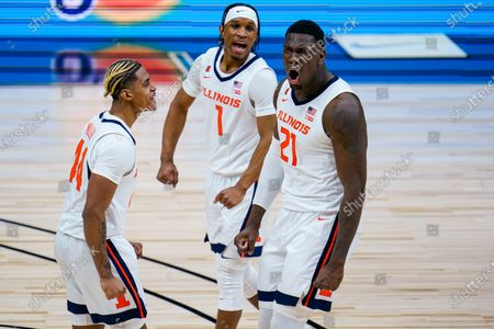 Illinois center Kofi Cockburn (21) celebrates with Trent Frazier (1) and Adam Miller (44) during the first half of the team's NCAA college basketball game against Rutgers at the Big Ten Conference men's tournament in Indianapolis