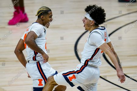 Illinois' Adam Miller, left, and Andre Curbelo celebrate during the second half of the team's NCAA college basketball game against Rutgers at the Big Ten Conference men's tournament in Indianapolis