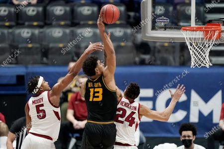Missouri's Mark Smith (13) drives to the basket against Arkansas' Moses Moody (5) and Ethan Henderson (24) in the first half of an NCAA college basketball game in the Southeastern Conference Tournament, in Nashville, Tenn
