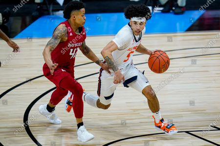 Illinois guard Andre Curbelo (5) drives Rutgers guard Jacob Young (42) in the second half of an NCAA college basketball game at the Big Ten Conference tournament in Indianapolis