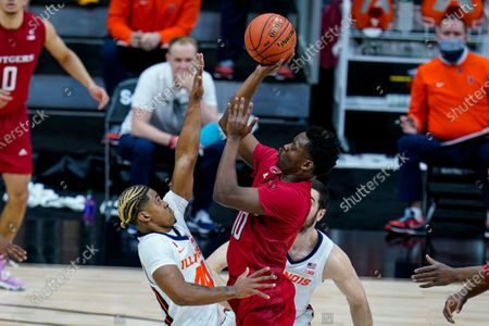 Rutgers guard Montez Mathis (10) shoots over Illinois guard Adam Miller (44) in the first half of an NCAA college basketball game at the Big Ten Conference tournament in Indianapolis