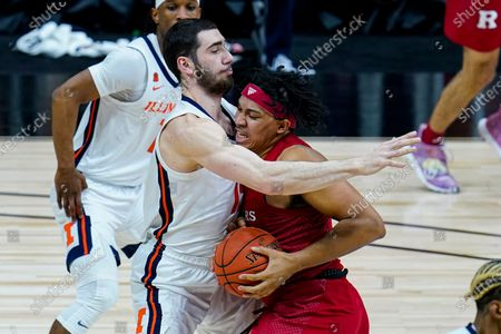 Illinois forward Giorgi Bezhanishvili (15) stops the drive so Rutgers guard Ron Harper Jr. (24) in the first half of an NCAA college basketball game at the Big Ten Conference tournament in Indianapolis