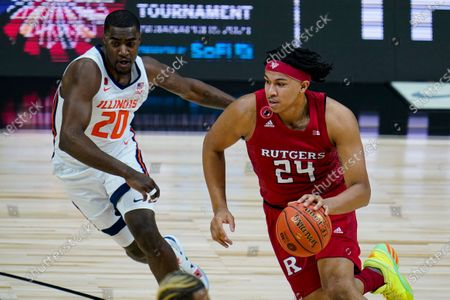 Rutgers guard Ron Harper Jr. (24) drives on Illinois guard Da'Monte Williams (20) in the first half of an NCAA college basketball game at the Big Ten Conference tournament in Indianapolis