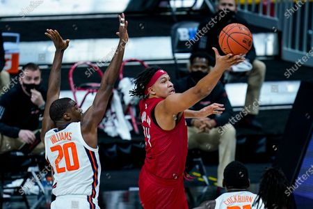 Rutgers guard Ron Harper Jr. (24) shoots in front of Illinois guard Da'Monte Williams (20) in the second half of an NCAA college basketball game at the Big Ten Conference tournament in Indianapolis