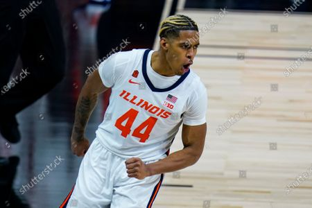 Illinois guard Adam Miller (44) reacts after a basket against Rutgers in the second half of an NCAA college basketball game at the Big Ten Conference tournament in Indianapolis