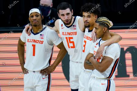 Illinois players Trent Frazier (1), Giorgi Bezhanishvili (15), Jacob Grandison (3) and Adam Miller (44) huddle in the second half of an NCAA college basketball game against Rutgers at the Big Ten Conference tournament in Indianapolis