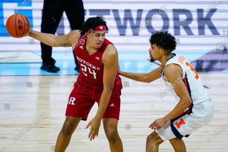 Rutgers guard Ron Harper Jr. (24) looks to drives on Illinois guard Jacob Grandison (3) in the second half of an NCAA college basketball game at the Big Ten Conference tournament in Indianapolis