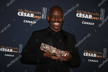 Jean-Pascal Zadi poses with the best male newcomer Cesar award for the movie 'Tout simplement noir'