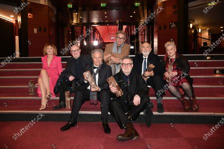 The Splendid Troop : (L to R) Marie-Anne Chazel, Michel Blanc, Christian Clavier, Thierry Lhermitte, Bruno Moynot, Gerard Jugnot and Josiane Balasko pose with the Honorary Cesar award