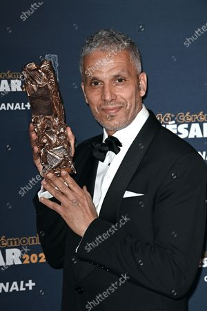 Sami Bouajila poses with the Best Actor Cesar award for the movie 'Un Fils' during the 46th Cesar Film Awards 2021 ceremony at l'Olympia in Paris on March 12, 2021 in Paris, France.