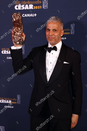 Stock Image of Sami Bouajila poses with the Best Actor award for 'Un fils' (A Son) during the 46th annual Cesar awards ceremony held at the Olympia concert hall in Paris, France, 12 March 2021.