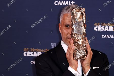 Stock Picture of Sami Bouajila poses with the Best Actor award for 'Un fils' (A Son) during the 46th annual Cesar awards ceremony held at the Olympia concert hall in Paris, France, 12 March 2021.