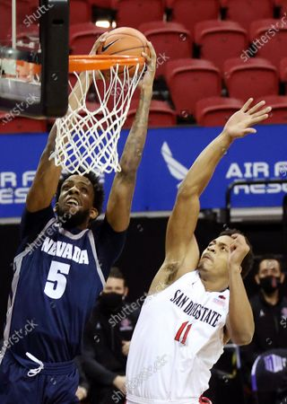 Nevada forward Warren Washington (5) dunks as San Diego State forward Matt Mitchell (11) defends during the first half of an NCAA college basketball game in the semifinal round of the Mountain West Conference men's tournament, in Las Vegas
