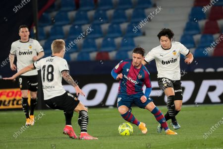 Enis Bardhi of Levante UD (C) in action against Daniel Wass of Valencia CF  (L) and Lee Kang-in of Valencia CF   (R)    during spanish La Liga match between Levante UD  and  Valencia CF  at Ciutat de Valencia  Stadium on March 12, 2021.