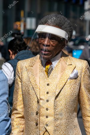 "Stock Picture of Andre De Shields is seen during the ""We Will Be Back"" Broadway Celebration in Times Square on March 12, 2021 in New York City. ""We Will Be Back"" was a special pop-up performance and commemoration of Broadway's ""lost year."" One year ago, on March 12, 2020, Broadway was shut down in an effort to slow the spread of the coronavirus and has not reopened."