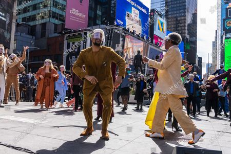 "The Times Square Alliance and the Broadway community host a pop-up performance ""We Will Be Back"" to commemorate the year lost to COVID-19 pandemic in New York City, United States on March 12, 2021."