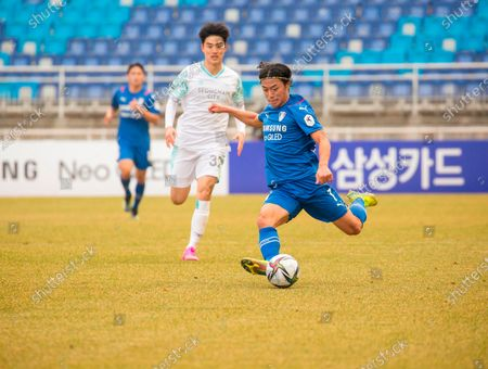 Stock Image of Ko Seung-Beom (R, Suwon Samsung Bluewings FC), Lee Tae-Hee (Seongnam FC) - Football / Soccer : The 2nd round of the 2021 K League 1 soccer match between Suwon Samsung Bluewings FC 1-0 Seongnam FC at the Suwon World Cup Stadium in Suwon, south of Seoul, South Korea.