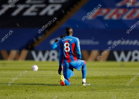 Cheikhou Kouyate of Crystal Palace kneels in support of anti-racism; Selhurst Park, London, England; English Premier League Football, Crystal Palace versus West Bromwich Albion.