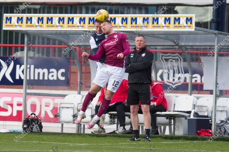 Scott Stewart of Arbroath competes in the air with Jordan Marshall of Dundee; Dens Park, Dundee, Scotland; Scottish Championship Football, Dundee FC versus Arbroath.