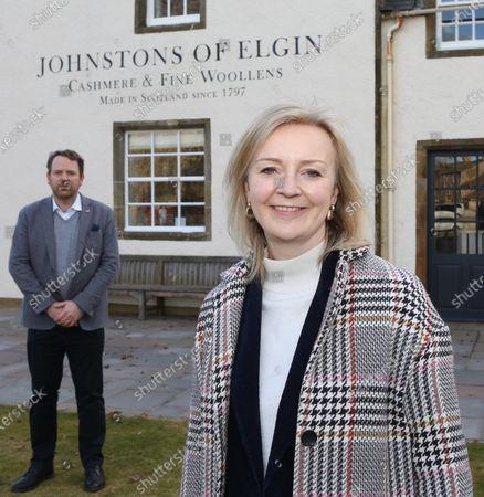 International Trade Secretary Liz Truss at the Johnstons of Elgin woolen mill with Simon Cotton(CEO of Johnstons).