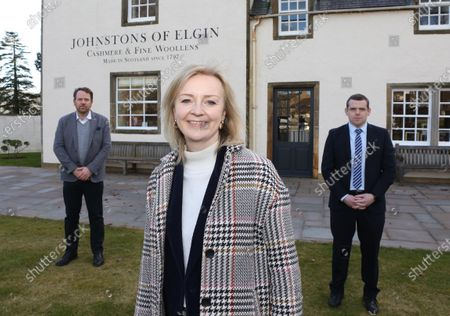 International Trade Secretary Liz Truss at the Johnstons of Elgin woolen mill with Simon Cotton(CEO of Johnstons) and Douglas Ross who is the Conservative party leader in Scotland.
