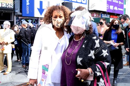 Stock Picture of Tamara Tunie and Lillias White participating in We Will Be Back, presented by Broadway Cares/Equity Fights AIDS, NYCNext, and the Times Square Alliance, held in Duffy Square, on March 12, 2021, in New York City.