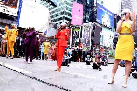 Stock Image of Peppermint, Lillias White, Nikki M. James, and Solea Pfeiffer participating in We Will Be Back, presented by Broadway Cares/Equity Fights AIDS, NYCNext, and the Times Square Alliance, held in Duffy Square, on March 12, 2021, in New York City.